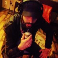 Liam Lloyd singing into a harmonica mic during a breakdown.